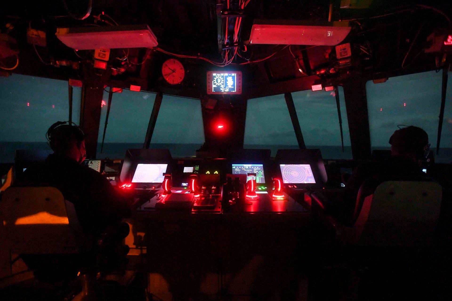Two Men Sitting In Navy Vessel