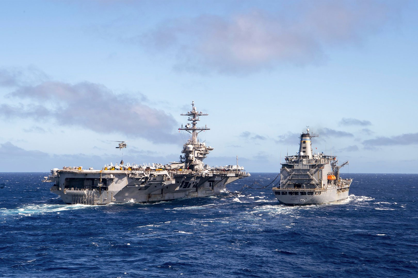 Naval Ships Traveling In The Ocean