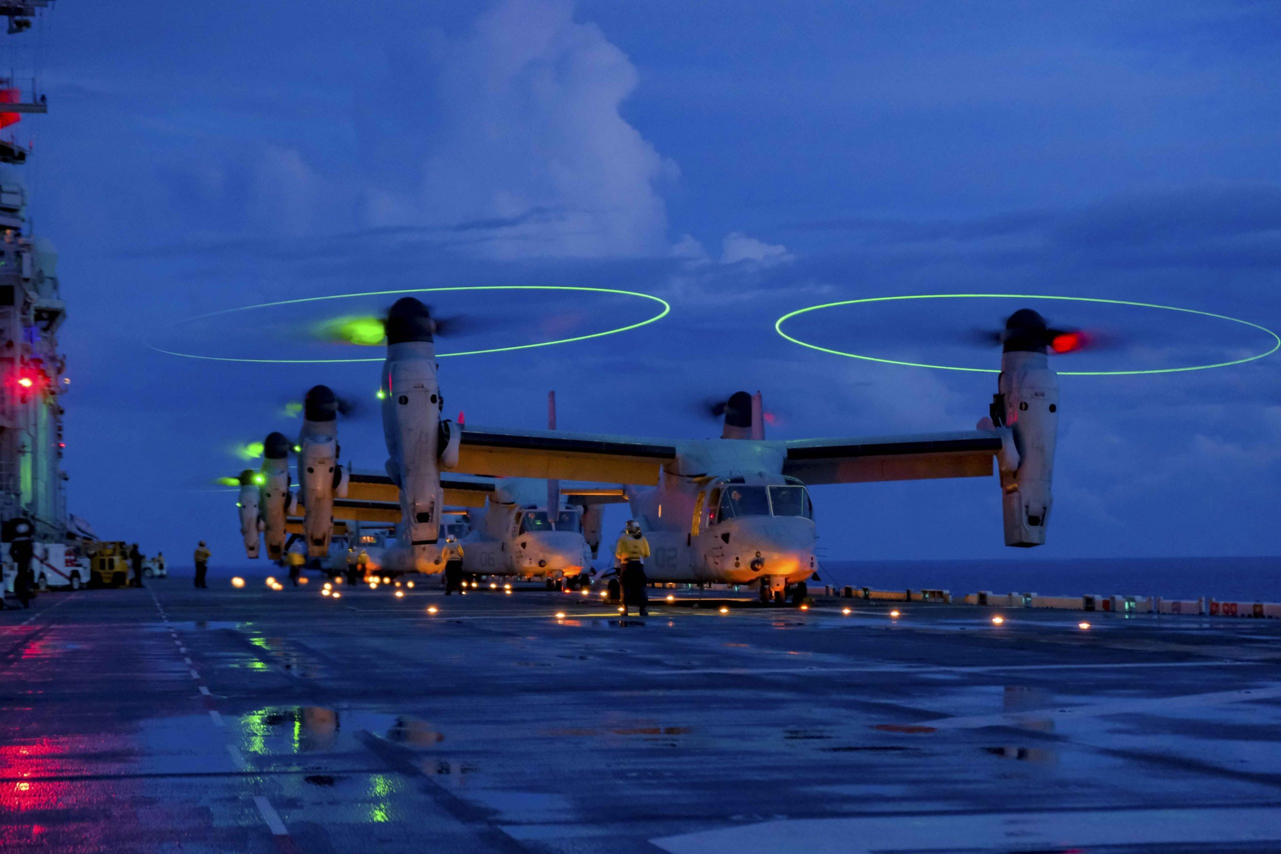 U.S. Marine Corps MV-22B's with Marine Medium Tiltrotor Squadron 265 (Reinforced), 31st Marine Expeditionary Unit (MEU), prepare for take-off aboard the amphibious assault ship USS America (LHA 6), in the Philippine Sea Aug. 17, 2021. The MV-22B provides combatant commanders with extended range and flexibility for a wide range of missions. The 31st MEU is operating aboard ships of America Expeditionary Strike Group in the 7th fleet area of operations to enhance interoperability with allies and partners and serve as a ready response force to defend peace and stability in the Indo-Pacific region. (U.S. Marine Corps photo by Staff Sgt. John Tetrault)
